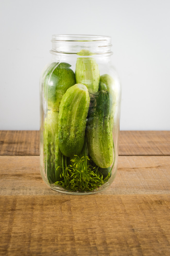 Packing cucumbers into jars